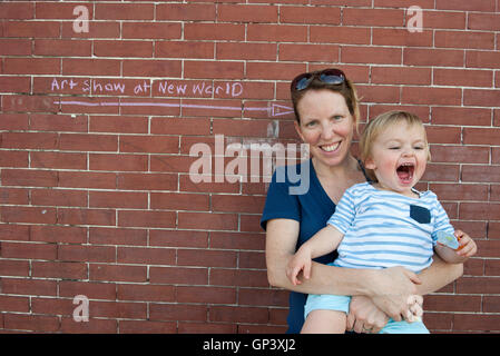 Mother and toddler son together outdoors, portrait - Stock Photo