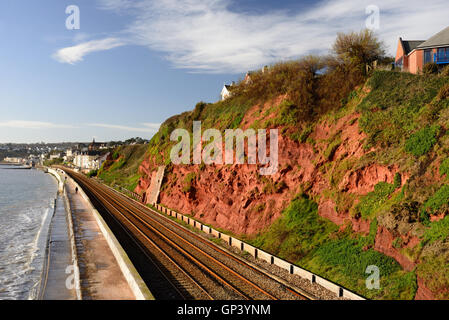 The railway line along Dawlish seafront, part of which was washed away by storms in 2014. - Stock Photo