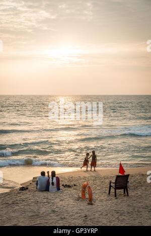 On holiday at Varkala beach, Kerala, India - Stock Photo