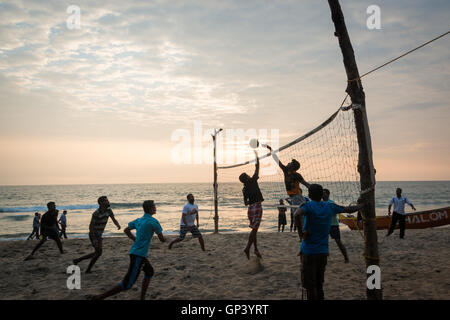 Kids playing volleyball on Varkala beach, Kerala, India - Stock Photo