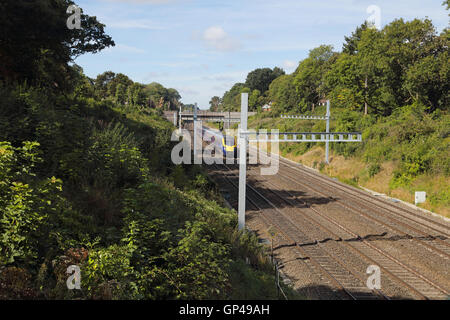 A 5 car 180 in Sonning cutting heading towards London on the up main line under the partially assembled Overhead - Stock Photo