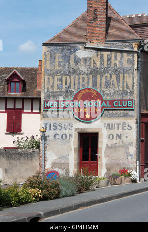 Old advertising on a building in the ancient town of Herisson in the Allier department Auvergne France - Stock Photo