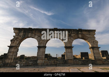 Three archway Volubilis, Morocco - Stock Photo