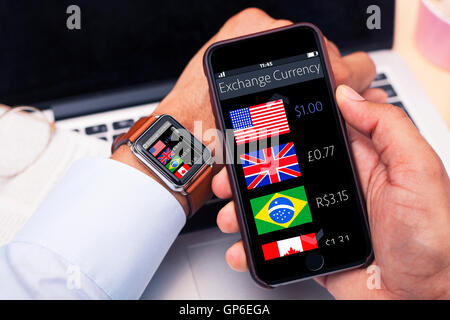 Businessman checking exchange currency through an app - Stock Photo