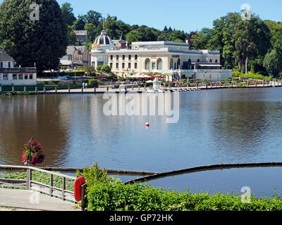 The lake, Casino and Casino Gardens in late summer in the old spa resort of Bagnoles de L'orne in Normandy, France. - Stock Photo
