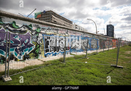 East side gallery graffiti art, paintings  on the remaining part of the Berlin wall - Stock Photo