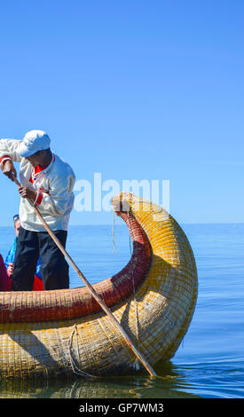 Unidentified native man in a traditional boat on Titicaca Lake - Stock Photo
