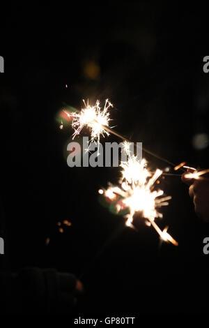 Sparklers on bonfire night - Stock Photo