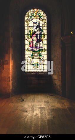 cathedral room with beautiful stain glass window - Stock Photo