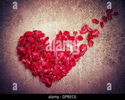 Illustration of rose petals arranged in shape of a broken heart. Breakup concept, separation and divorce icon. Symbol of medical