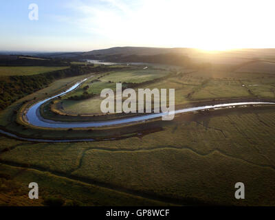 Water meadows and Cuckmere river flowing through the South Downs National Park. - Stock Photo