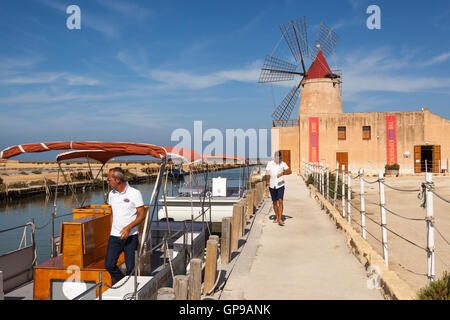 Salt Museum and boats at Stagnone salt pans, Stagnone, near Marsala and Trapani, Sicily, Italy - Stock Photo