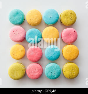 Sweet and colourful french macaroons or macaron on white background, Dessert. - Stock Photo