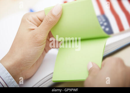Human hands holding adhesive note with with empty space - Stock Photo