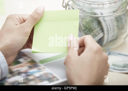 Hands of businessperson holding adhesive note with empty space - Stock Photo