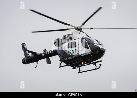 Kent Surrey Sussex Air Ambulance G-KAAT landing. - Stock Photo
