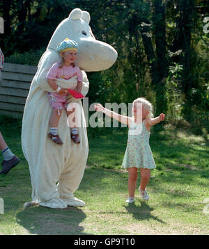 Moomin with children amused by characters from fairy tales - Stock Photo
