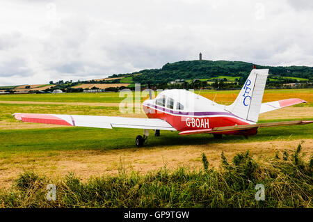 G-BOAH Piper PA-28-161 Warrior II (1984) on the grass at Newtownards airfield. - Stock Photo