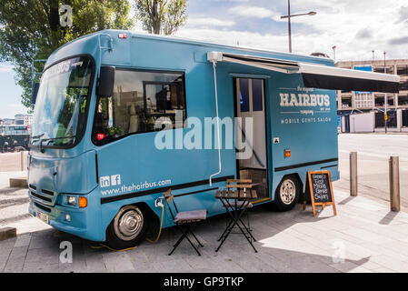 The Original Hairbus, a mobile barbers shop male grooming salon in a van, Belfast - Stock Photo