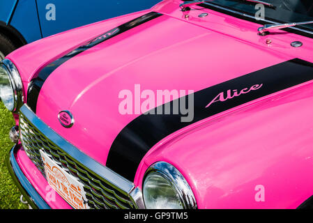 Pink Austin Mini Cooper S, nicknamed 'Alice Cooper' at a Mini Car Owners' Club exhibition - Stock Photo