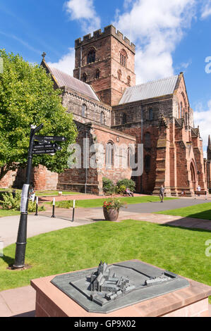 1/16th scale Model of the Priory with Carlisle cathedral in the background, Cumbria, England, UK - Stock Photo