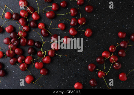 Dark food background with cherries. Top view - Stock Photo