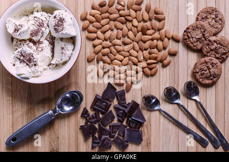 Sweet ice-cream desert with nuts and chocolate - Stock Photo