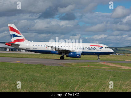 British Airways Airbus A320-232on runway at Inverness Airfield about to take off.  SCO11,222. - Stock Photo