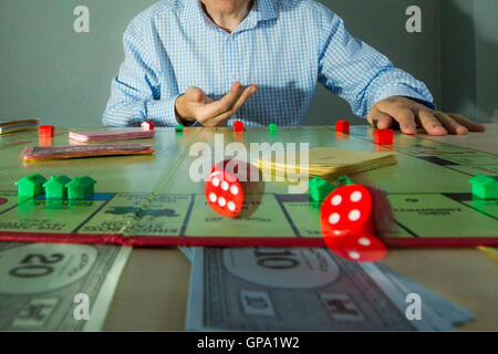 Player playing Monopoly - Stock Photo