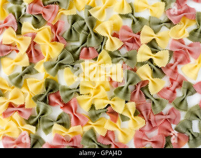 Multicolored Farfalle Pasta on White Background - Stock Photo