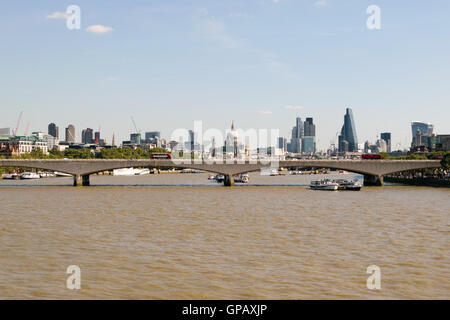 London, UK - 30 August 2016: View of Waterloo Bridge and the financial district in the background. - Stock Photo