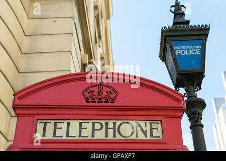 Metropolitan Police marked post near red telephone symbol box in London, England - Stock Photo