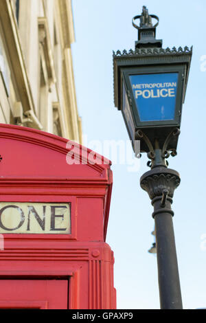 Metropolitan Police marked post near red telephone symbol box in London, England - Stock Photo
