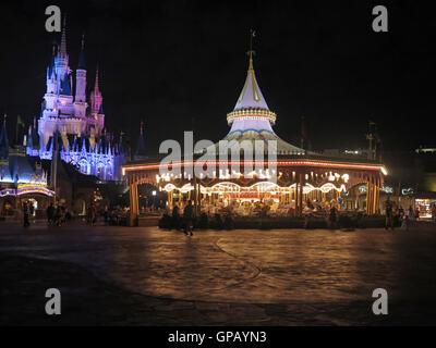 Orlando, Florida. March 4th, 2015. Prince Charming Regal Carousel and the Cinderella Castle a night,Magic Kingdom, - Stock Photo