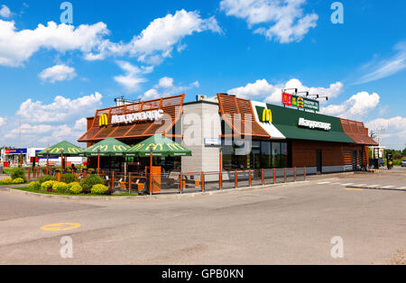 McDonald's fast food restaurant in summer day. McDonald's is the world's largest chain - Stock Photo