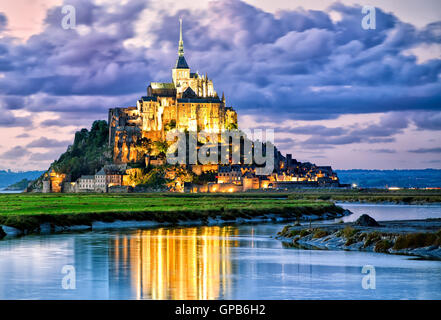 Mont Saint-Michel is one of France's most recognizable landmarks, listed on UNESCO list of World Heritage Sites. - Stock Photo