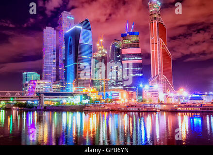 Skyscrapers in Moscow City financial district at night time, Russian Federation - Stock Photo