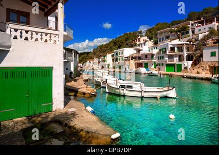 White villas and boats on green water in picturesque fishermen village Cala Figuera, Mediterranean Sea, Mallorca, - Stock Photo