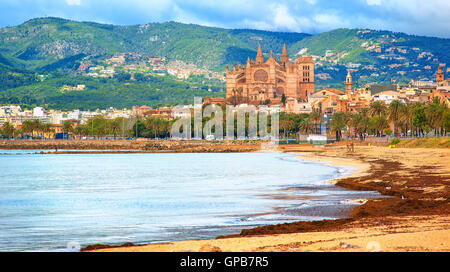 Panoramic view of Palma beach with La Seu cathedral in background, Mallorca, Spain - Stock Photo