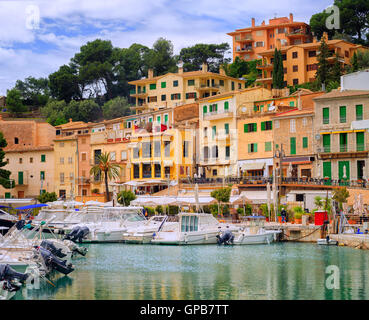 Motor boats and traditional waterside houses in Puerto Soller, Mallorca, Spain - Stock Photo