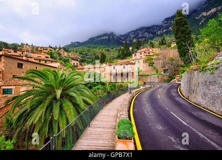 Winding asphalt road in rural area of Tramontana mountains, Mallorca, Spain - Stock Photo