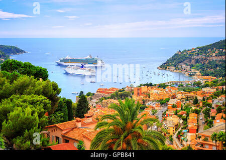 Cruising ships in a lagoon of Villefranche on french Riviera by Nice, France - Stock Photo