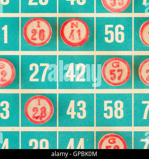 Wooden numbers used for bingo - Stock Photo