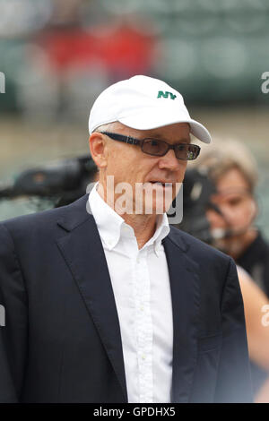 Sep 25, 2011; Oakland, CA, USA;  New York Jets owner Woody Johnson on the sidelines before the game against the - Stock Photo