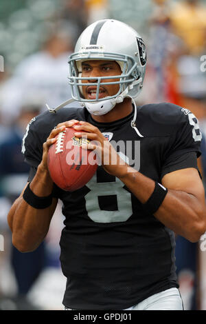 Sep 25, 2011; Oakland, CA, USA;  Oakland Raiders quarterback Jason Campbell (8) warms up before the game against - Stock Photo