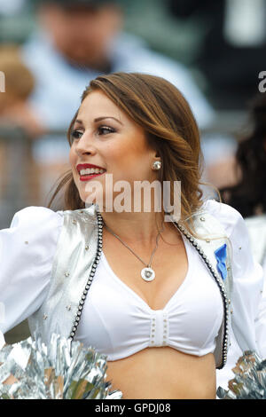 Sep 25, 2011; Oakland, CA, USA;  An Oakland Raiders cheerleader performs before the game against the New York Jets - Stock Photo