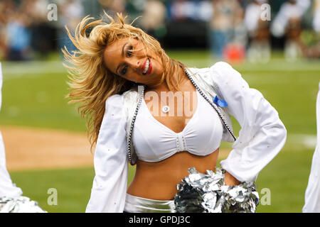 Sep 25, 2011; Oakland, CA, USA;  An Oakland Raiders cheerleader performs during the second quarter against the New - Stock Photo
