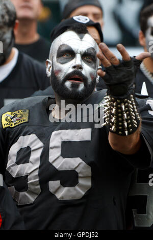 Sep 25, 2011; Oakland, CA, USA;  An Oakland Raiders fan cheers his team during the second quarter against the New - Stock Photo