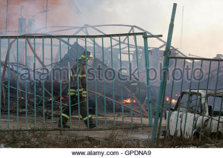 a fire broke out in a household electrical fuse box flames a firefighter walks at the site of a burnt fair that was selling mainly household items
