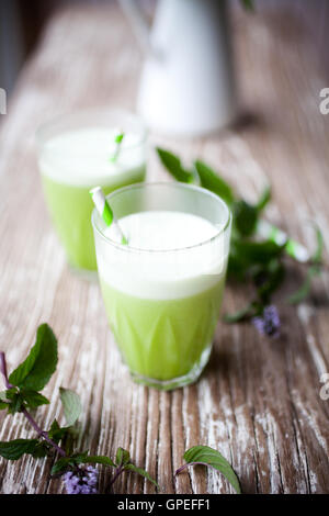 Healthy green juice from fruit and vegetable - Stock Photo